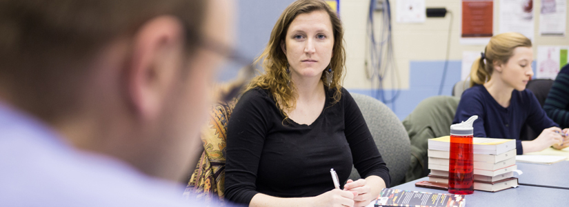 photo of a graduate student participating in a group discussion
