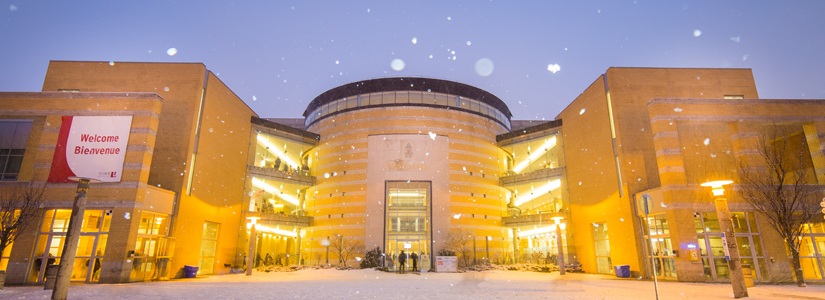 photo of the exterior of Vari Hall on a snowy evening