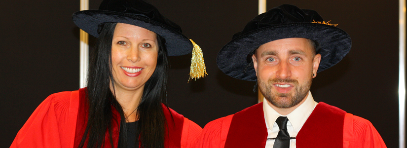 photo of two doctoral students from June 2016 convocation