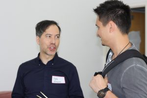 Photo of a Faculty Member and Student in Conversation
