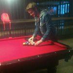 Photo of someone playing pool