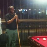 Photo of group of people playing pool